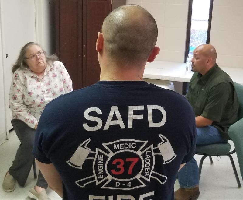 A mental health crisis intervention team trains with a woman acting out signs of dementia