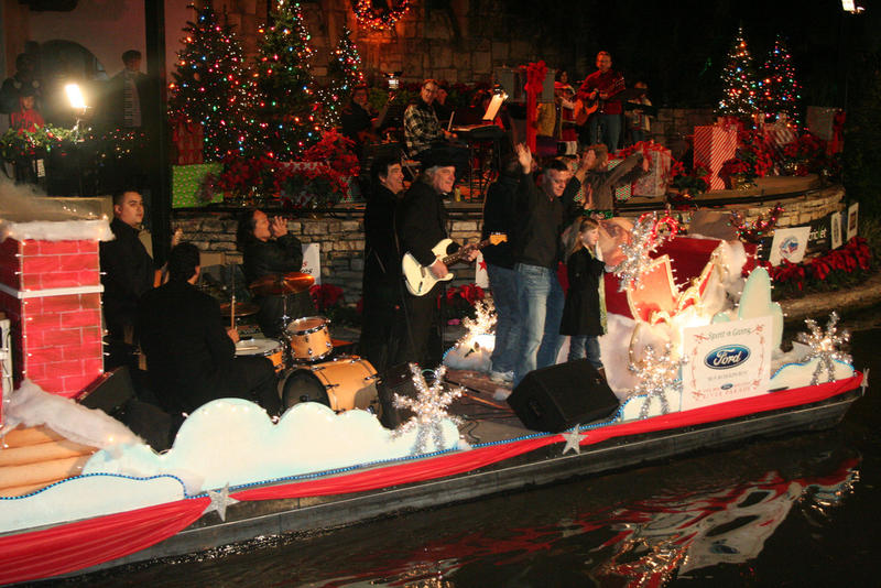 local band The Kraylos rocking their float