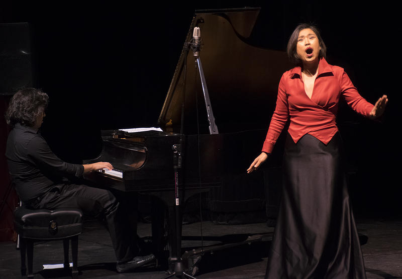Dr. Minkyung Lee (standing) sings at NVC's Fall Music Fest. At piano: Aaron Prado