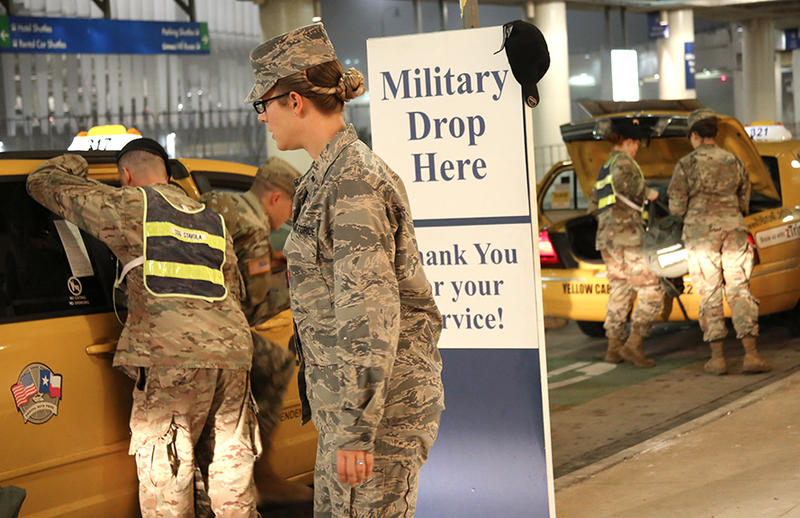 Military personnel arriving at San Antonio Airport