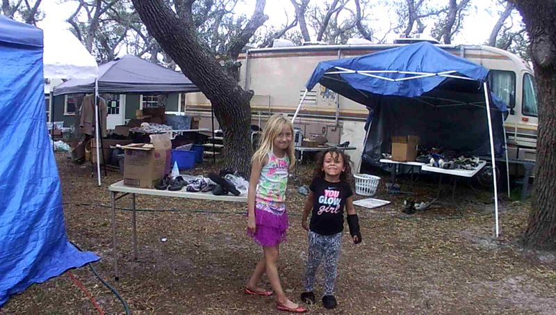 Two young hurricane evacuees at a tent city near Fulton, Texas