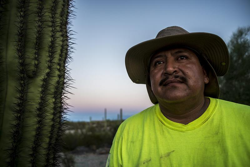 Ely Ortiz, founder of Aguilas Del Desierto, poses for a portrait on Aug. 26, 2017, at the base camp outside Ajo, Arizona, where he and nearly two dozen others prepare for daylong treks into the desert to search for missing migrants.