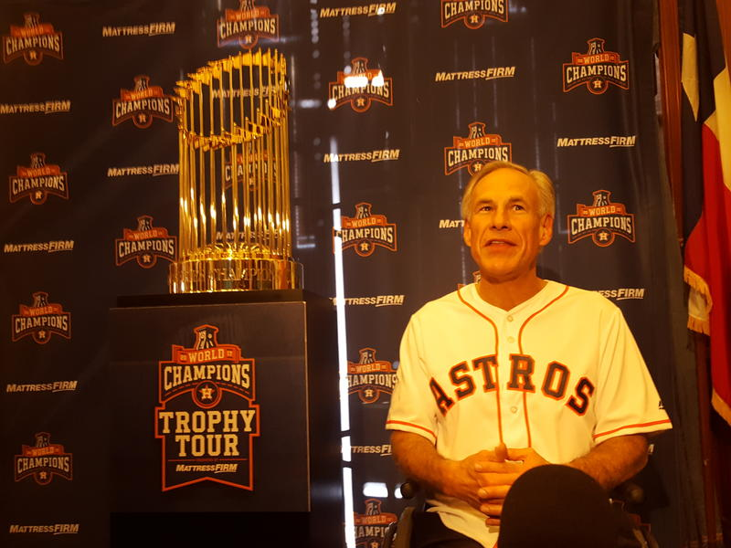 Gov. Greg Abbott and the 2017 World Series trophy at the state Capitol.
