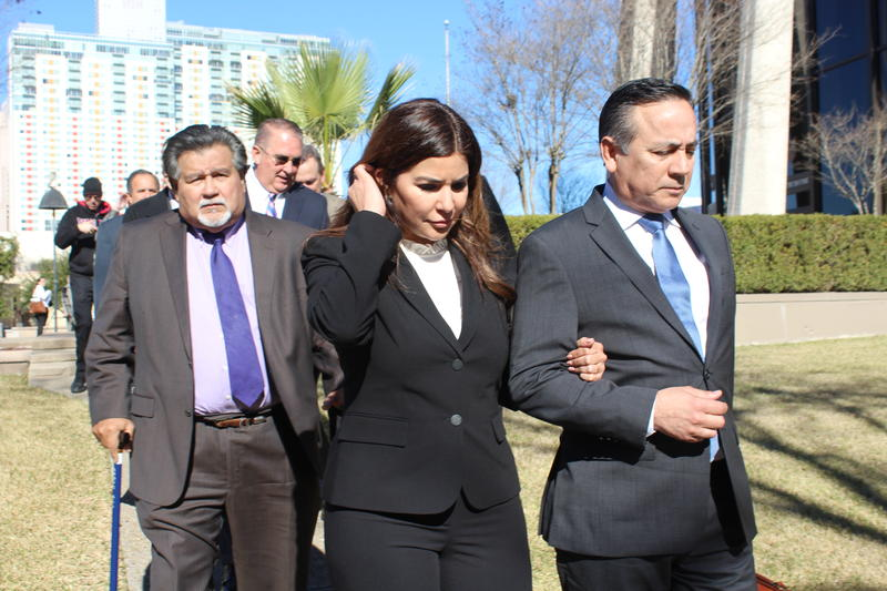 State Sen. Carlos Uresti, on right, and his wife Lleanna Uresti leave arm in arm from the downtown federal courthouse on Monday.