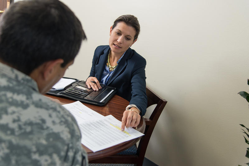 Brooke Fina, associate professor of psychiatry with UT Health San Antonio and a therapist who works in the STRONG STAR office at Fort Hood, meets with a service member about prolonged exposure therapy.