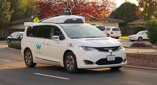 Autonomous Waymo Chrysler Pacifica Hybrid minivan undergoing testing in Los Altos, California.