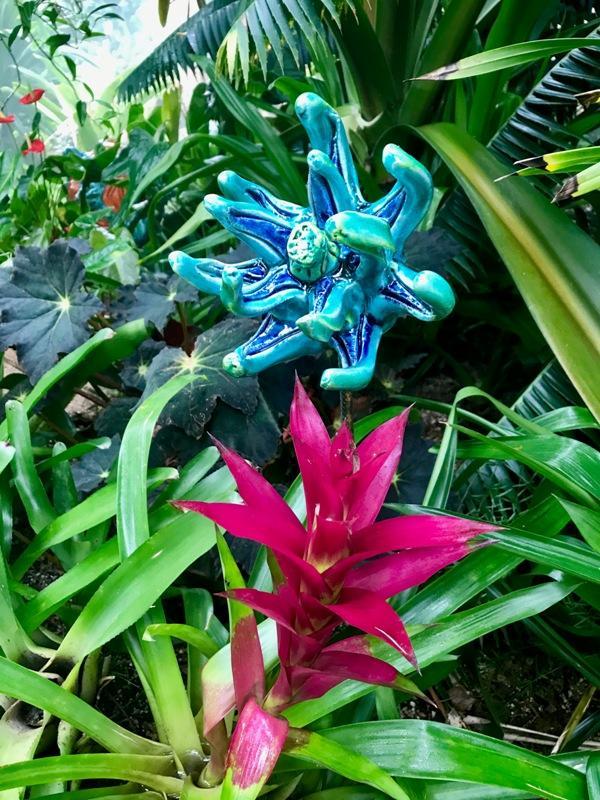 Diana Kersey piece next to a bromeliad