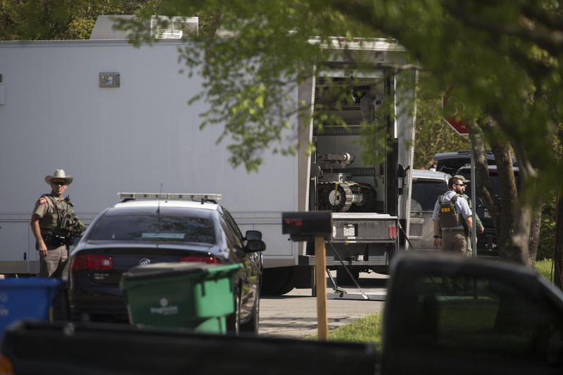 Officials brought two bomb-detecting robots to the Pflugerville home of the suspect in the Austin bombings.
