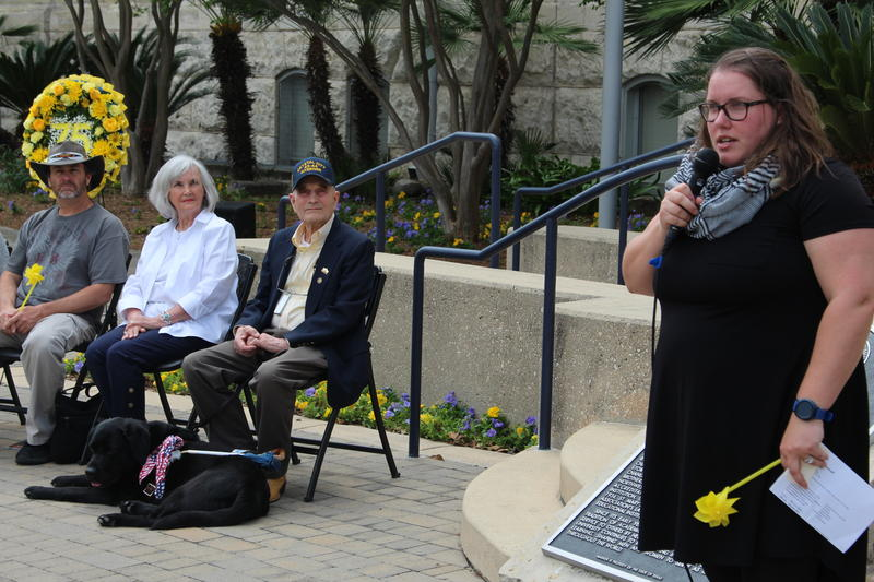 Lindsey Wieck, a professor at St. Mary's, addresses a crowd outside of St. Louis Hall. Adolf Wesselhoeft, his wife Shirley, and relation Scott Harrison look on.