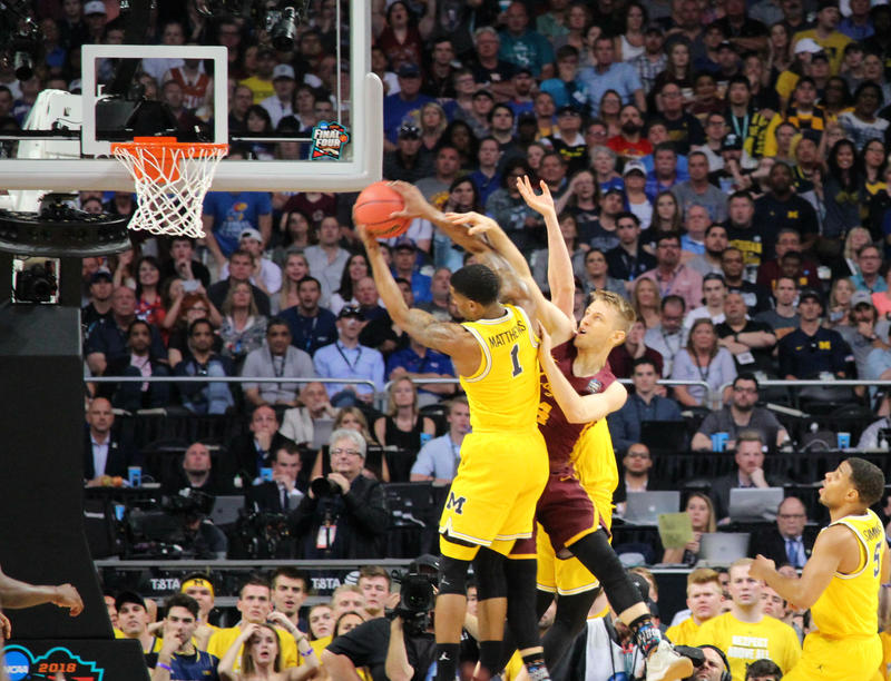 Michigan's Charles Matthews pulls down a rebound.