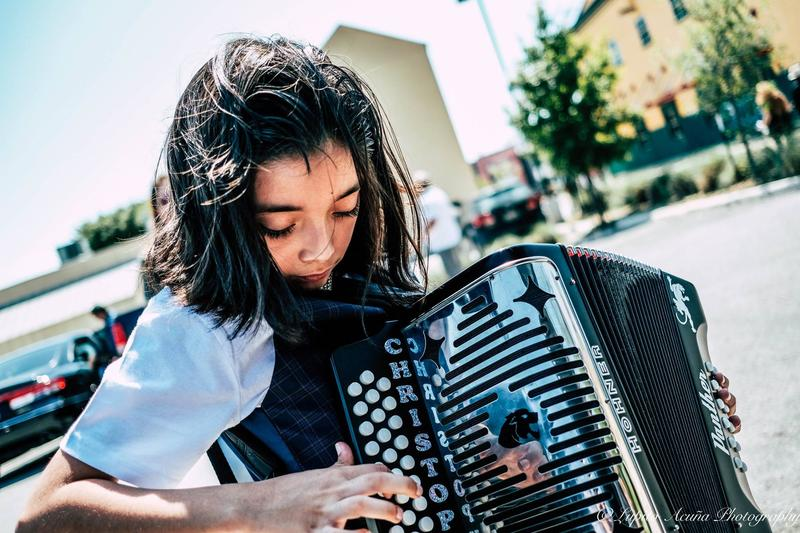 Christopher Ramirez plays the accordian during a squeezebox competition.