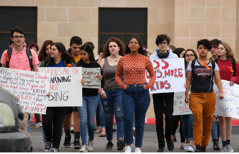 Churchill High School students walk out of class to call for tighter gun control laws April 20, 2018.
