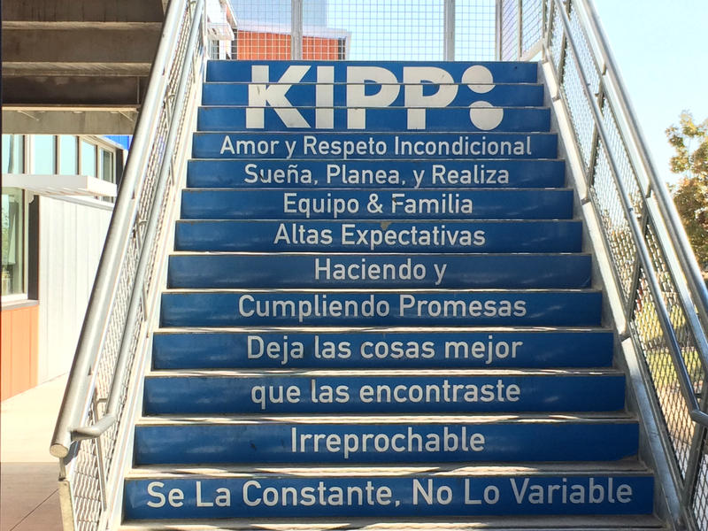 A stairwell on the KIPP San Antonio campus with an inspirational  message in Spanish.