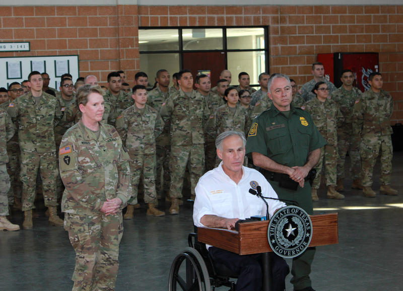 Gov. Abbott briefs media and National Guard troops, flanked by Brig. Gen Tracy Norris of the Texas National Guard, left, and  Rio Grande Valley Sector Border Patrol Chief Manuel Padilla.