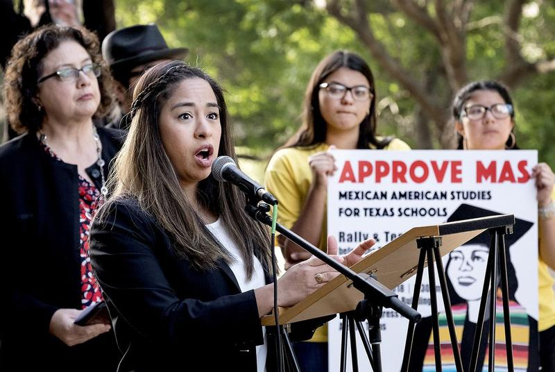 State Board of Education member Marisa Perez-Diaz speaks to a group of people rallying for the inclusion of Mexican-American studies in public school curriculum outside the Texas Education Agency on April 11, 2018.