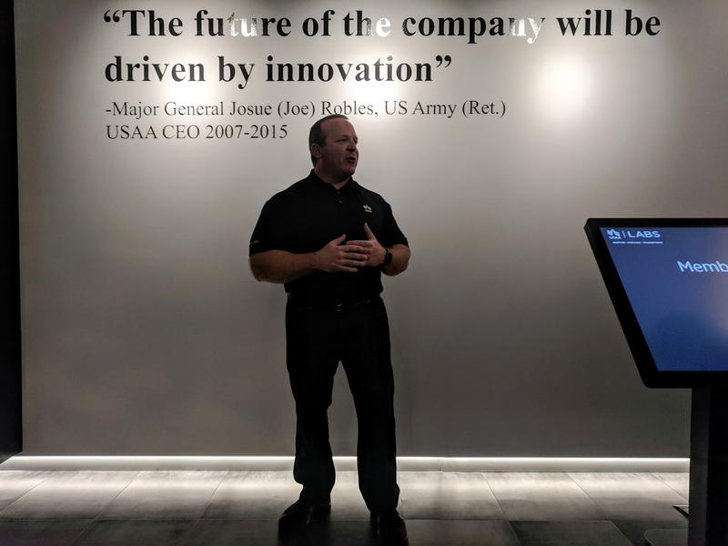 Zak Gipson opens USAA's new innovation exhibit space.