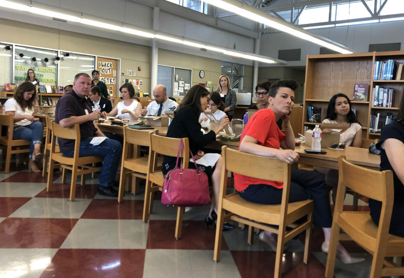 Business and non-profit members listen to a speaker during a luncheon May 23, 2018 at Fox Tech High School.