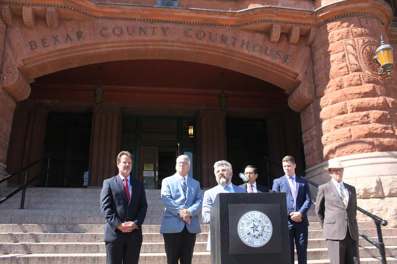 Attorney Martin Phipps talks about the details of the county's lawsuit in front of the Bexar County Courthouse