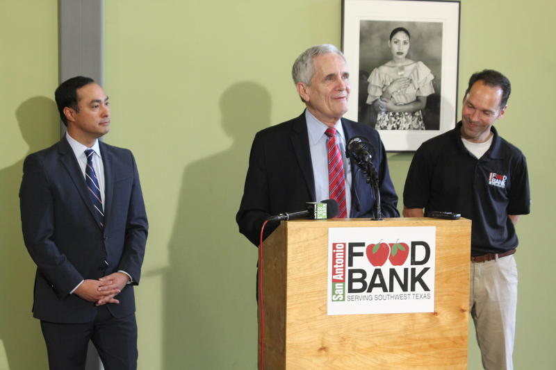 San Antonio Congressmen Joaquin Castro, from left, and Lloyd Doggett join San Antonio Food Bank CEO Eric Cooper to talk about the impacts of the Farm Bill.