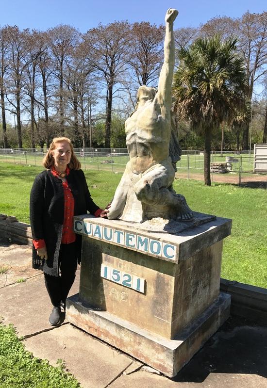 Lynn Osborne Bobbitt with the statue of Cuatemoc.
