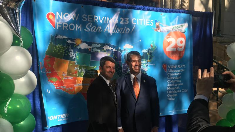 San Antonio Aviation Director Russ Handy (left) poses  with San Antonio Mayor Ron Nirenberg for a photo following Thursday's announcement