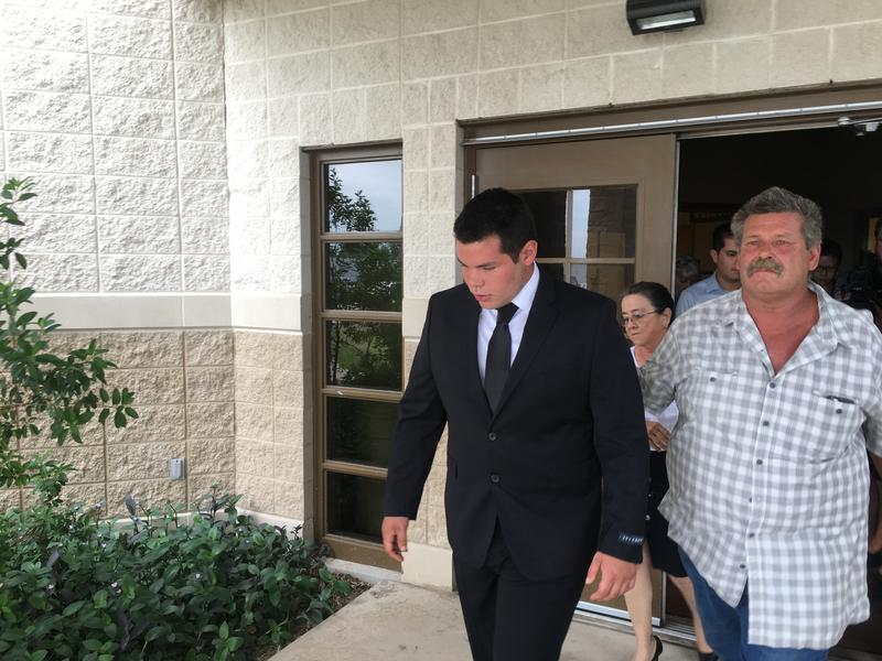 Jack D. Young, right, leaves the Ulvalde County Justice Center shortly after entering a no contest plea