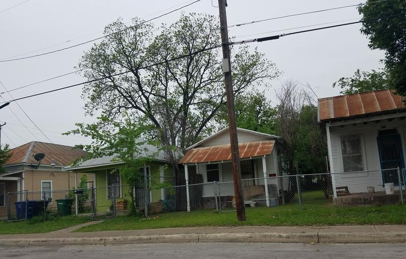 Row of shotgun houses on San Antonio's Westside.