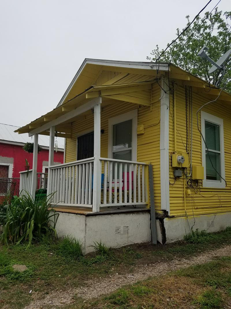 Brightly colored shotgun house on San Antonio's Westside.