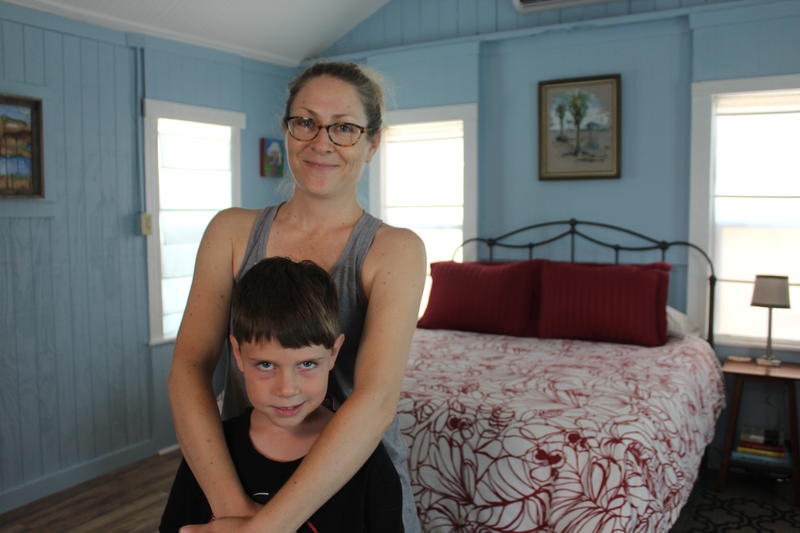 Flora Buerger and her son Harris pose for a photo inside a newly renovated cottage.