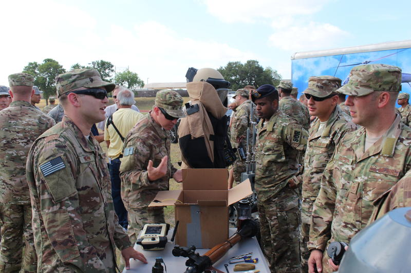 Members of the 330th recruiting squadron speak with experts in explosive ordnance disposal, one of the six special operations career fields.