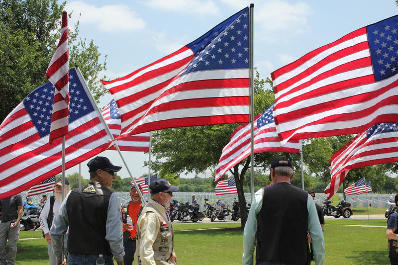 Members of the Patriot Guard Riders welcome eight veterans' cremains to Fort Sam Houston National Cemetery.