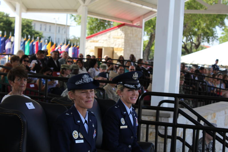 Brig. Gen. Heather Pringle (left) and Brig. Gen. Laura Lenderman (right) hear remarks from Lt. Gen. Steven Kwast of Air Education and Training Command.