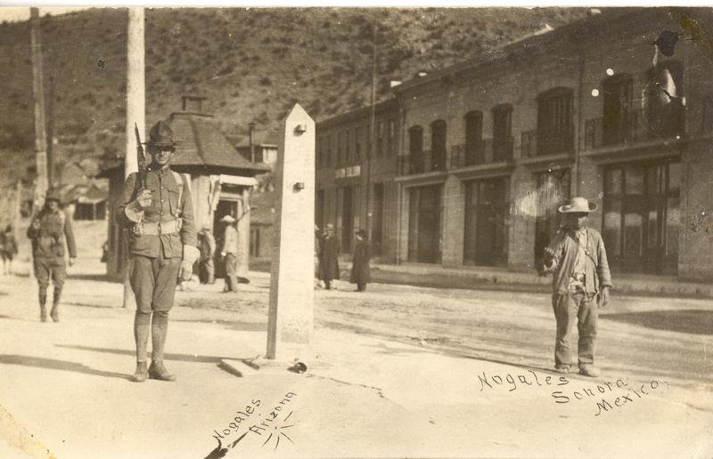 U.S. Army soldiers and Mexican soldiers guarding the international border at Nogales, Arizona, and Nogales, Sonora, during the Mexican Revolution (1910-1920). The metal obelisk at the center is a border marker.