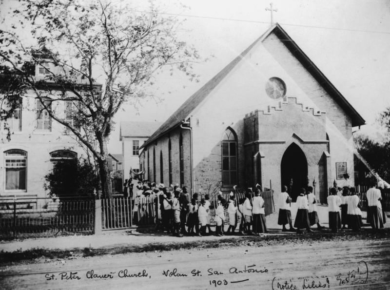 Students are pictured in procession around St. Peter Claver Church in 1903.