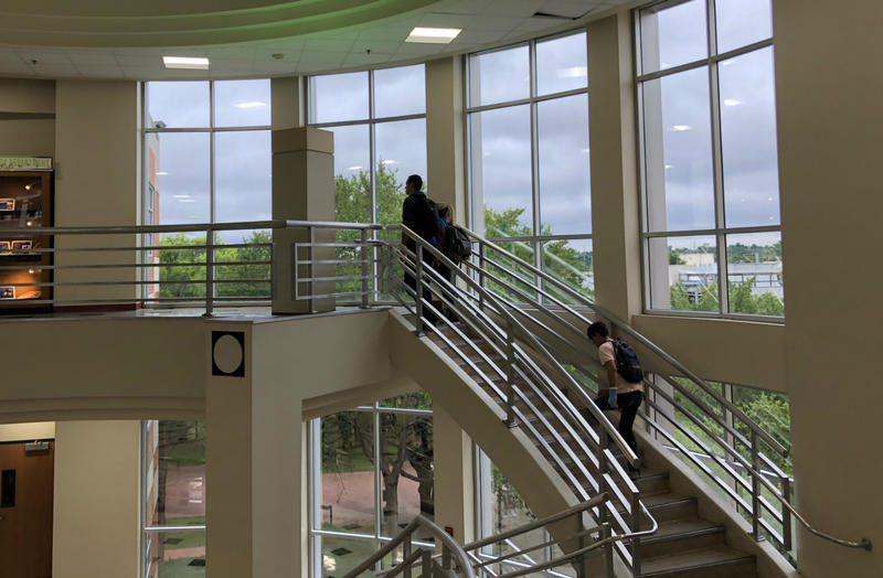 Students climb the stairs of the Chance Academic Center on the San Antonio College campus in June, 2018.
