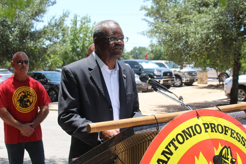 Fire union president Chris Steele speaks outside the Julia Yates Semmes Library on Nacodoches rd in Northeast San Antonio