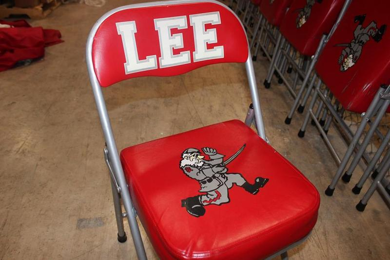 Folding chairs featuring a Confederate soldier are among the items for sale in the Lee High School online auction.