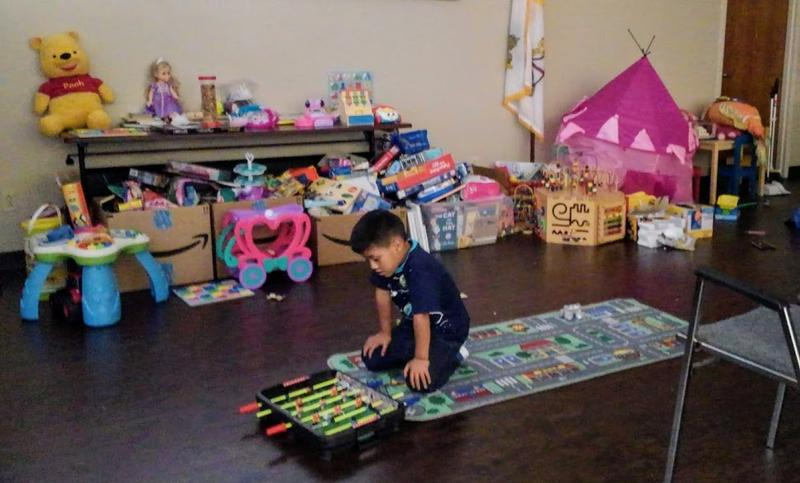 An immgrant child plays at Catholic Charities of San Anotnio after being reunited with his family.