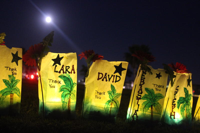 Lighted bags line the sidewalk at Robert's Point Park near the Port Aransas marina. Each bag has the name of someone that a Port Aransas resident wanted to thank