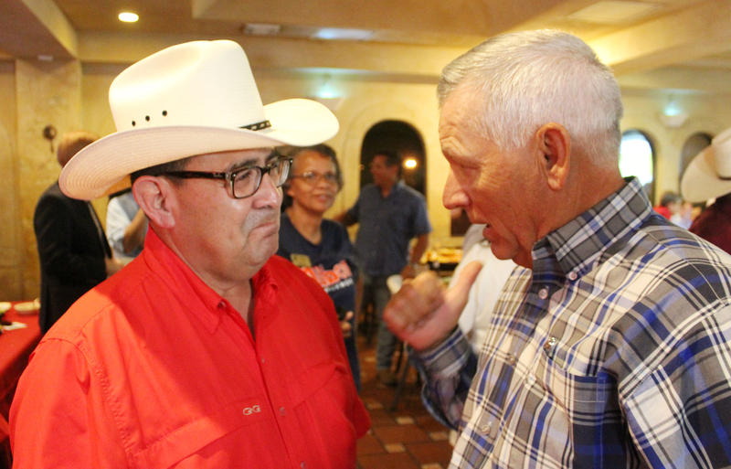 Republican Pete Flores, left, talks to one of his supporters after receiving 34 percent of votesat a special election for Texas Senate District 19. Flores now heads to a runoff with Democrat Pete Gallego, who had 29 percent of the vote.