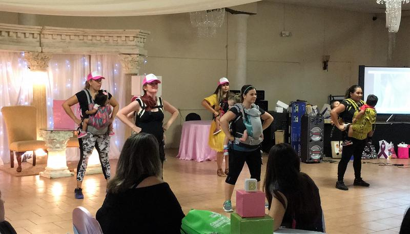 The Babywearing Dancers perform for dozens of moms-to-be at Healthy Start's community baby shower on the South Side.