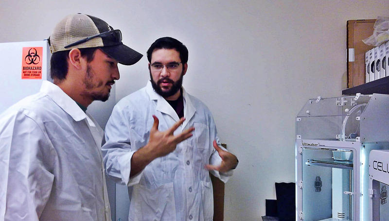 Lyle Hood, right, of UTSA's College of Engineering and UTSA engineering student Daniel Portillo discuss the 3D printing process in UTSA's Medical Design Innovations Lab.