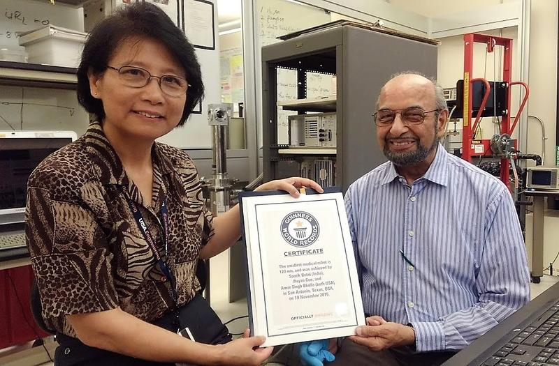 UTSA engineering professors Ruyan Guo, on left, and Amar Bhalla display their Guinness World Records certificate confirming the medical robots made in their lab are the tiniest on Earth.