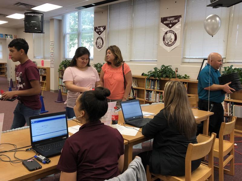 Eighth grader Miranda Martinez picks up her iPad at Harris Middle School Sept. 21, 2018.