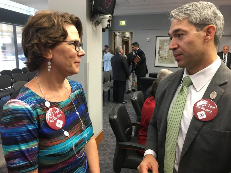 Metro Health Director Dr. Colleen Bridger speaks with San Antonio Mayor Ron Nirenberg after presenting the progress on the taskforce to City Council