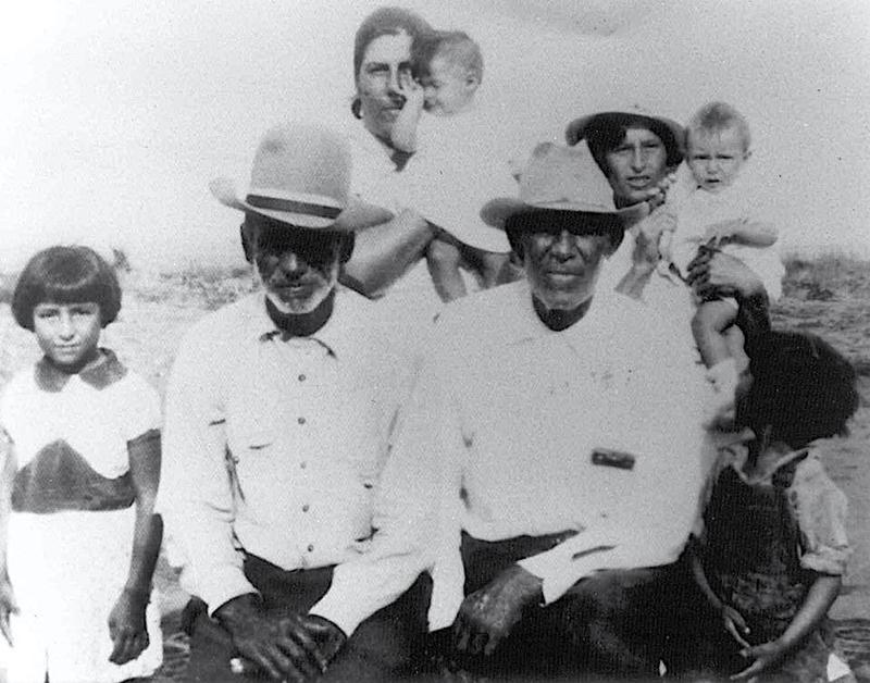 "Arlinda Valencia: ""This is the only picture of my great grandfather Longino Flores. He is on the right with my great grandmother Juana Bonilla right behind him.  The man to the left is my grandfather Rosendo Mesa."" (undated photo)"