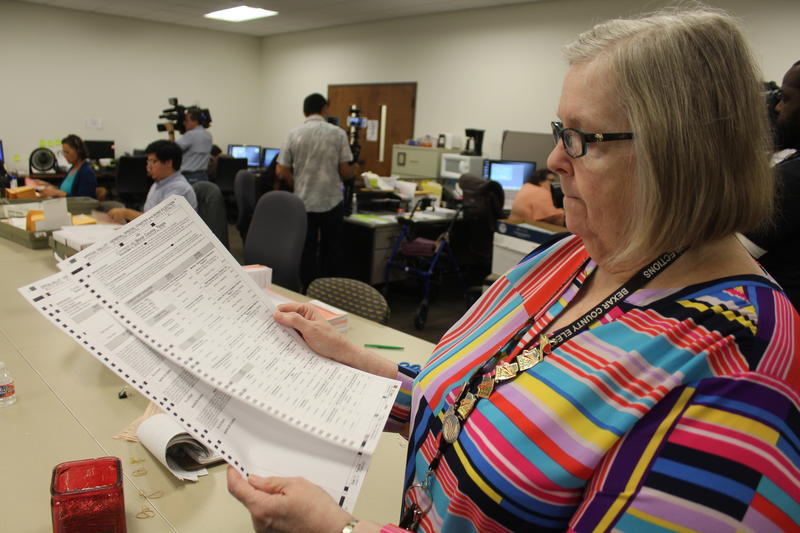 Bexar County Elections Administrator Jacque Callanen holds a sample ballot in the mailroom of the elections office