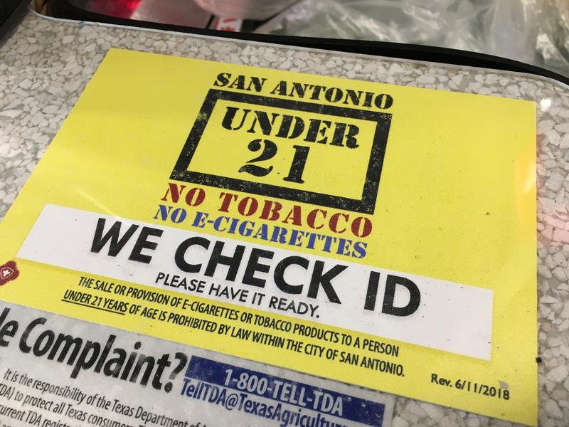 A checkout counter at the H-E-B on Austin Highway shows tobacco purchases can only be made by those over 21-years-old.
