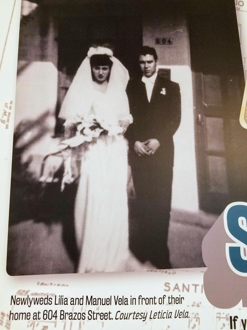 An exhibit panel displaying the 1947 wedding photo of Alazán-Apache Courts residents, Lilia and Manuel Vela