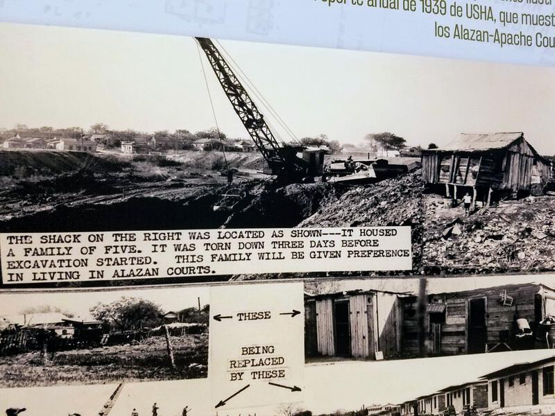Exhibit panel displaying the shacks that were eventually demolished and replaced by the Alazán-Apache Courts.